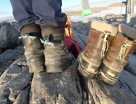 Two pairs of boots with string markers attached