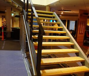 Staircase from below, wooden treads, dark grey balustrade