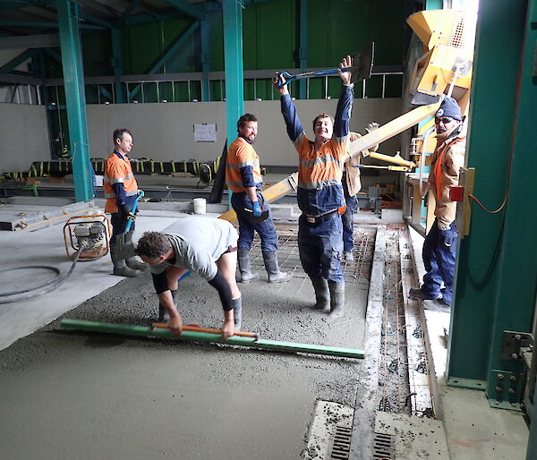 Tradesmen working on a concrete slab