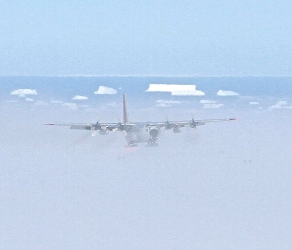 C130 Cargo Aircraft approaching to land on ice ski landing area