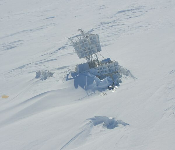 Picture of the structure of a NASA high altitude radio wave antenna embedded in snow