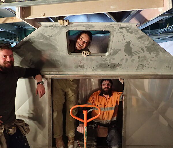 Expeditioners photographed inside a snow plenum