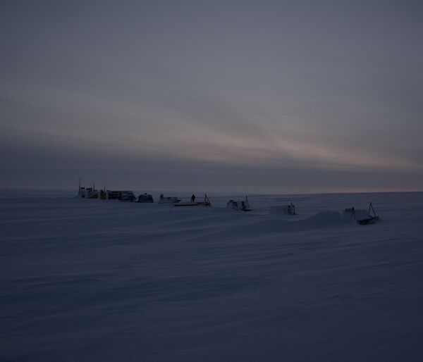 Remote camp with a series of modules spaced evenly in a line on ice