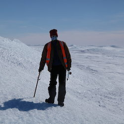 Lotter is standing on the side of an ice blister, near Channel Lake on the Sørsdal glacier.