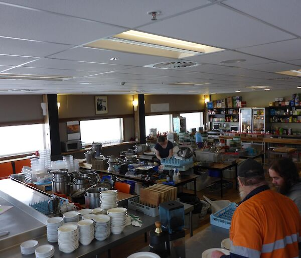 The Davis mess area, normally for expeditioners to sit and enjoy meals full of pots, pans, cooking utensils, dry food.