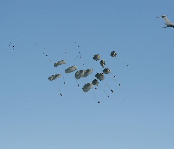 Cargo being delivered by parachute out the back of a C-17 RAAF aircraft.