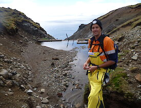 Summer plumber Tim at Gadgets Dam, filled with silt from the landslide.