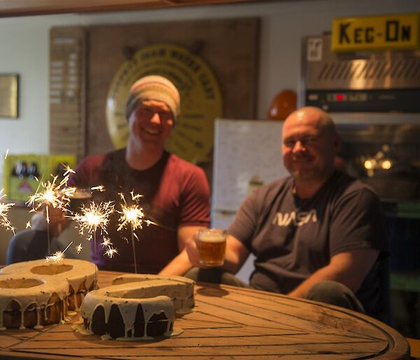 Rich (and Rob with their birthday cake with sparklers