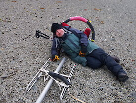 A man on the ground next to the antenna