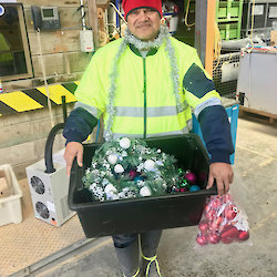 One of Santa's Macca Elves (aka Cliff) preparing Christmas decorations.