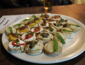 A plate full of canapes colourfully decorated