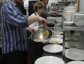Helping in the kitchen to plate up the Midwinter Dinner