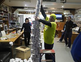 A toilet roll tower constructed in one of the Macca Green Sponge games held over Midwinter