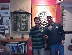 Chris B & Rich in front of a dartboard in Macca Mess