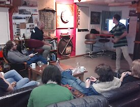 The Macca team watching relaxing and watching the darts in the recent inter-station darts tournament