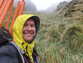 Selfie of Rich at Far North Precarious Bay with the dense and tall tussock in the background