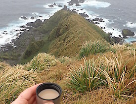 Rich having a cup of tea perched out on the ridge-line of Precarious Point supervising some Southern Giant Petrels as they get ready to start their breeding season