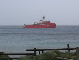 L'Astrolabe sailing past Garden Bay to take up position in Buckles Bay ready for passenger and cargo transfers