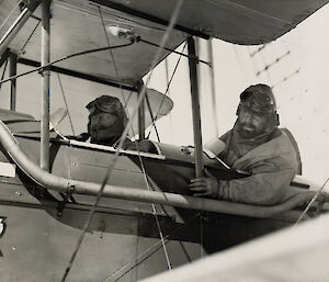 Two men in a small light aircraft