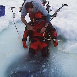 Diver being assisted with harness