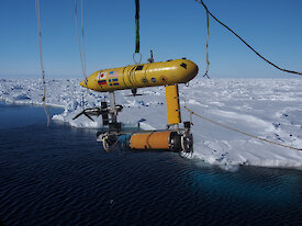 The Autonomous Underwater Vehicle (AUV) being lowered off the stern of the ship. The data from the AUV will be used to make 3-D maps of the underside of the sea ice (Photo: Wendy Pyper)