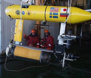 Crew members Doug Hawes (Integrated Rating) and Joe Macmenemy (Bosun) prepare to deploy the Autonomous Underwater Vehicle from the trawl deck of the ship (Photo: Wendy Pyper)