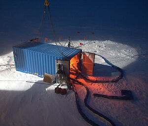 The on-ice container housing the krill pump operates late into the night (Photo: Kym Newbery)