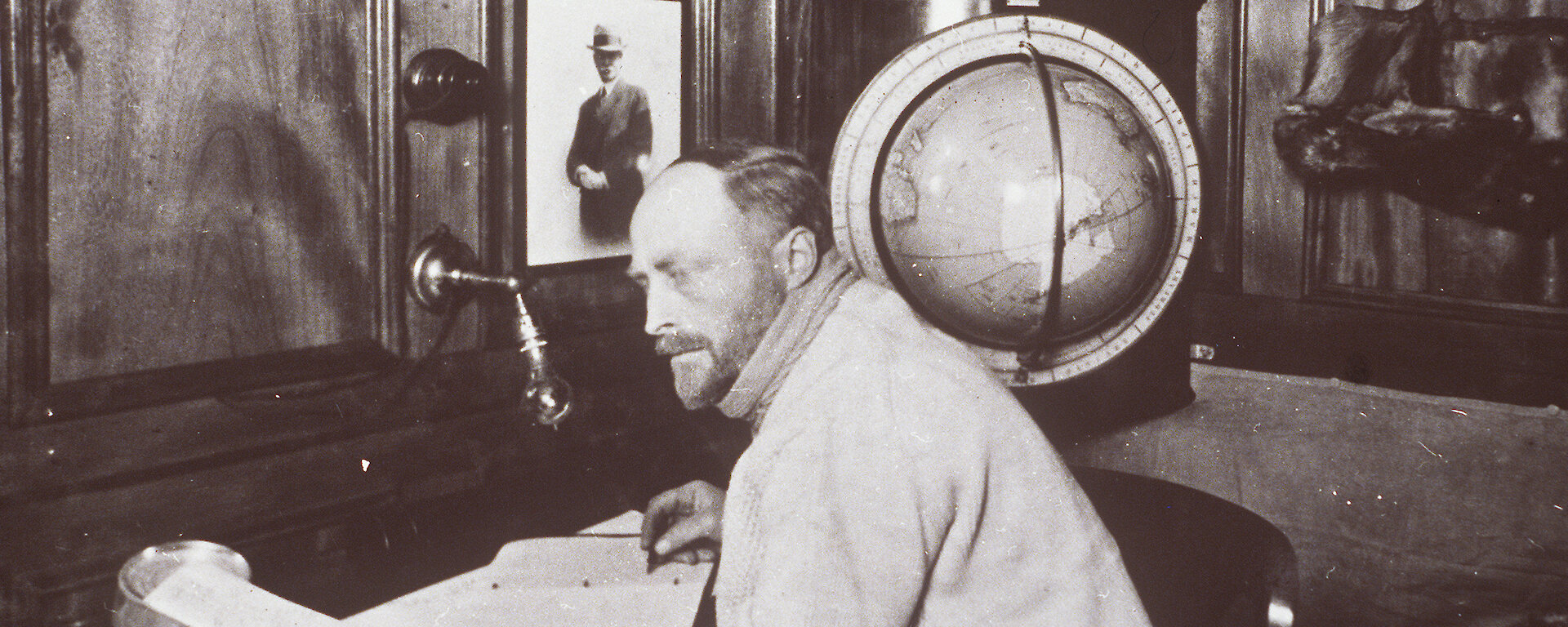 Sir Douglas Mawson in the Commander's Cabin on the Discovery, 1929.