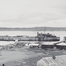 The HMALST 3501, later known as the HMAS Labuan on first ANARE voyage to Heard Island. Image shows ship at Kerguelen Island at Port Jeanne d'Arc for bunkering between 30 December 1947 and 1 January 1948