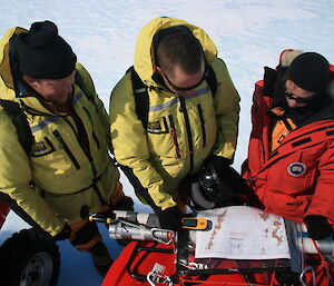 Expeditioners looking at map