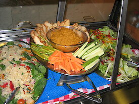 Dips and fresh vegetables displayed around the plate