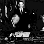 United States representative, Herman Phleger, sits at a desk to sign the Antarctic Treaty in December 1959.