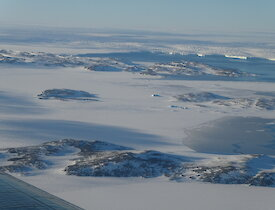 The Browning Peninsula with the Vanderford Glacier in the distance from up in the Basler JKB
