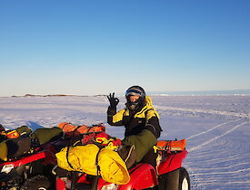 Antarctic expeditioner on quad bike