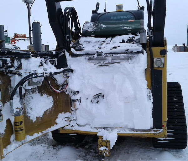 Blizzed Skid Steer Cat 297C in Antarctica