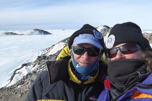 Scientists Colin and Louise stand atop their rocky island office