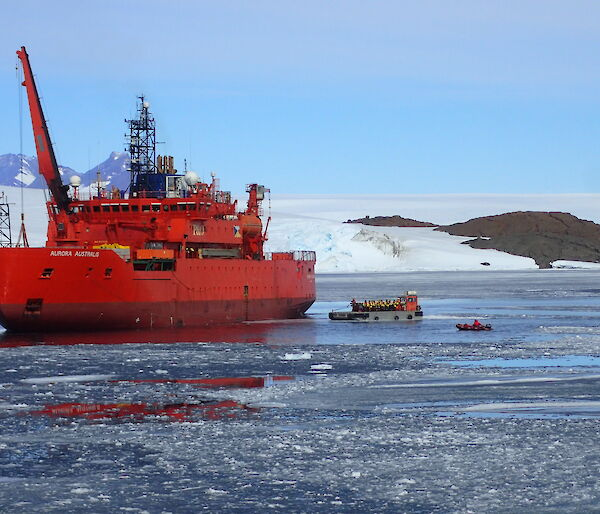 Incoming Mawson expeditioners transferring to shore via barge in Kista Strait