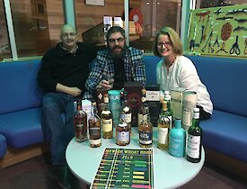 Mawson expeditioners Geoff, Chris, and Jan enjoy a whisky tasting night.