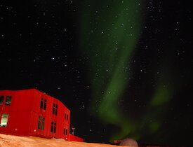 Another spectacular Mawson aurora over the iconic Red Shed.