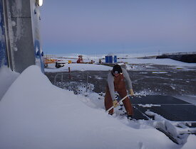 BoM Senior Observer Roelof helping to clear snow from the Balloon Shed after another Mawson blizzard.