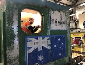 Mawson winter electrician Warren 'Wazza' Arnold hard at work on internal repairs of Rumdoodle Hut.