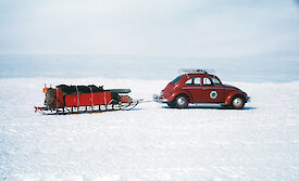 The Ruby-Red Antarctica 1 VW car towing a sled across the snow