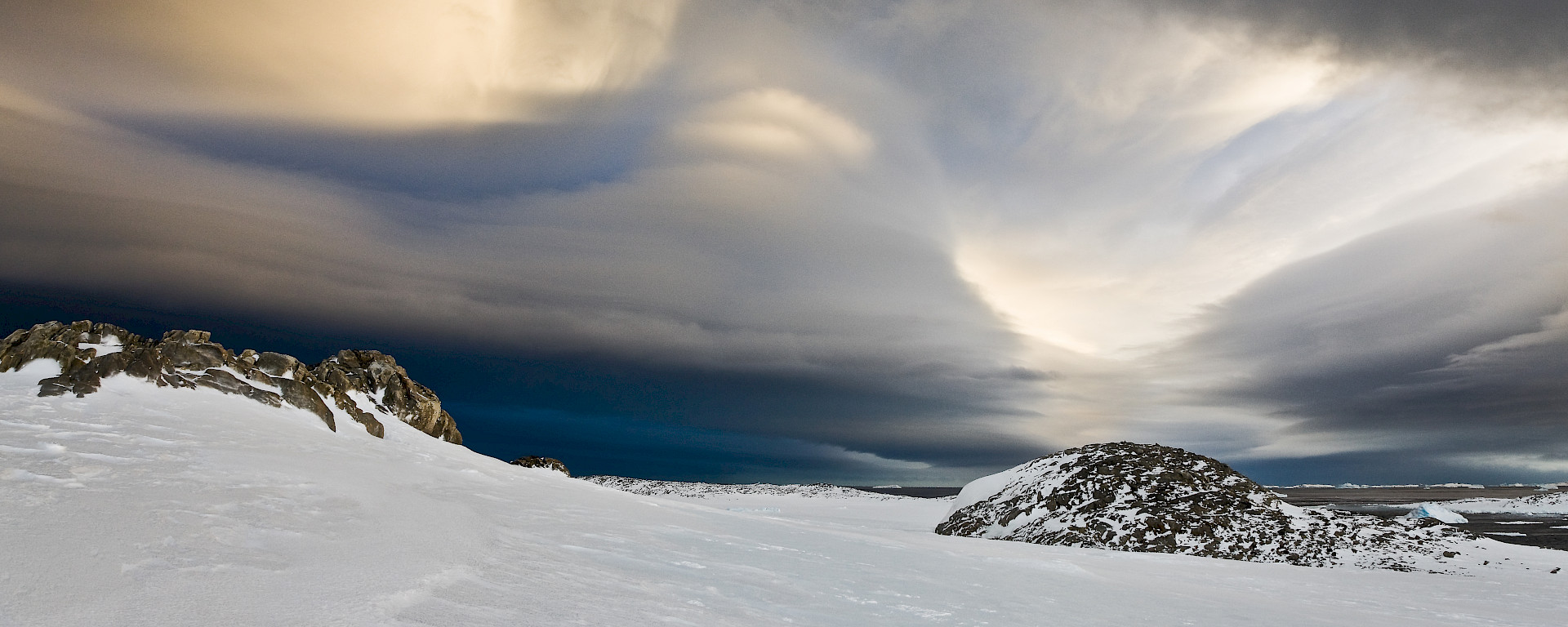 Clouds above an icy landscape.