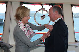 Governor-General pinning medal on Captain Doyle