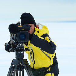 Man behind a camera in a whiteout