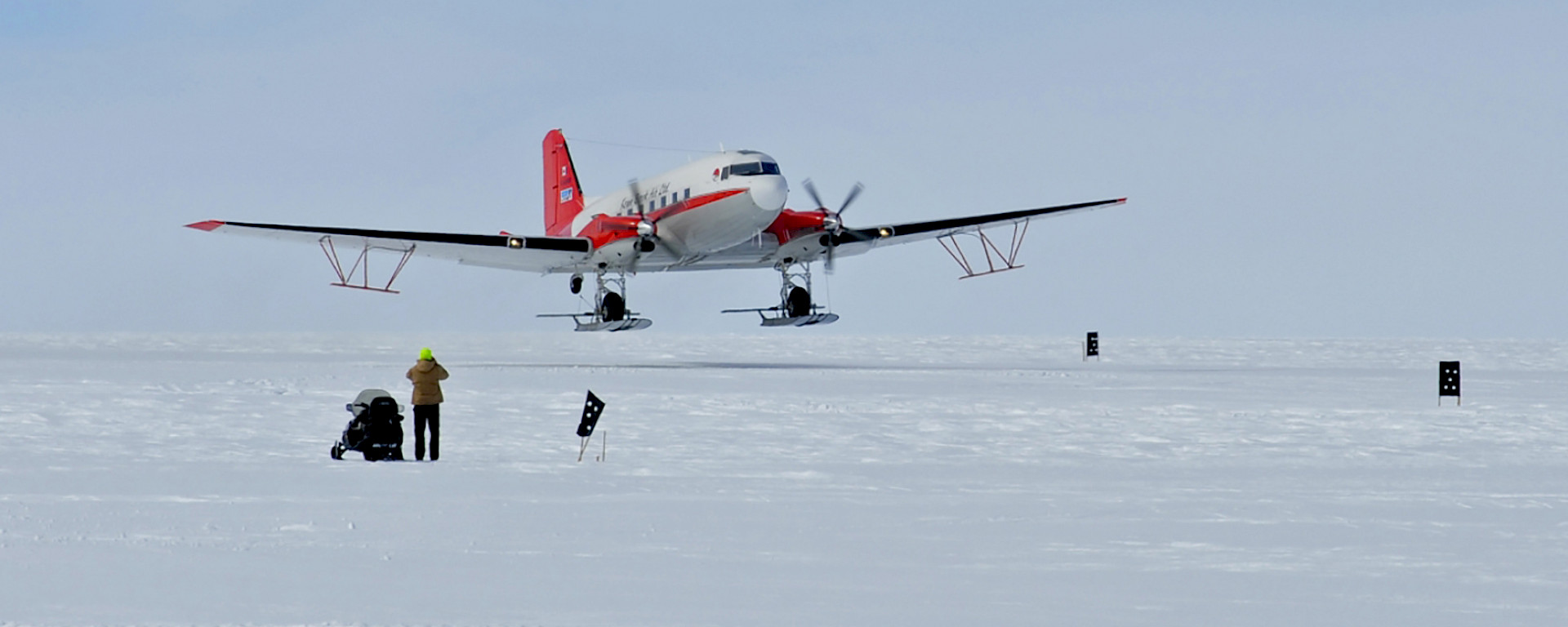 The 72 year old Basler BT-67 aircraft with its wing-mounted, ice penetrating radar antennae.