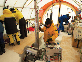 Scientists drilling for an ice core at Aurora Basin.