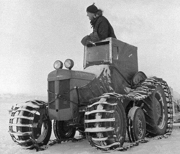 Man on a tractor on the ice