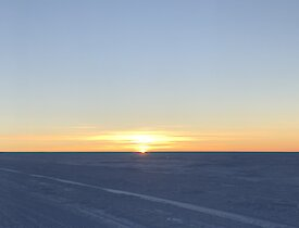 The sun rising over the ice plateau