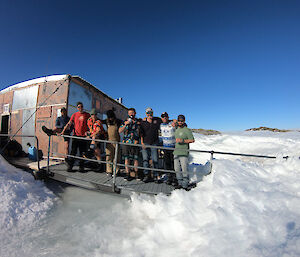 A group of expeditioners outside a field hut